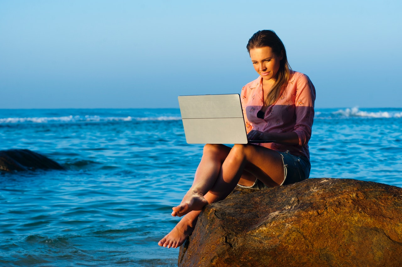 working on beach woman ocean